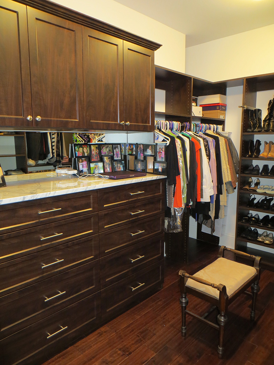 Walk In Closet design with cabinets